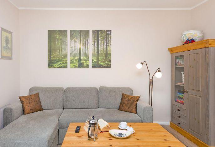 Wohnbereich mit Couch und Recamiere