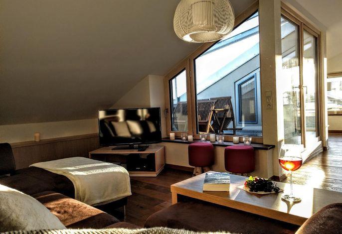 Offener Wohnbereich, Blick auf die Dachterrasse