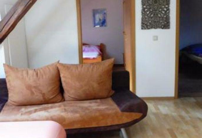 Wohnung Bacchus, Wohnbereich, 2 Doppelschlafzimmer, Bad mit Dusche und WC und separates WC.
