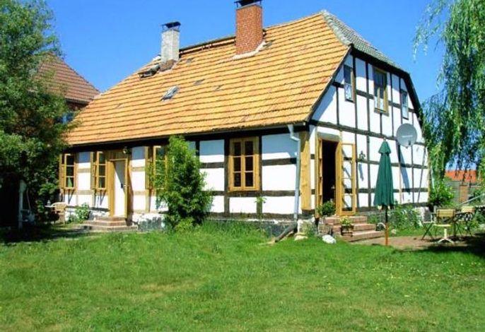 Fischerhaus Godewind Gartenansicht, Ihr Hausteil wäre der linke im EG.