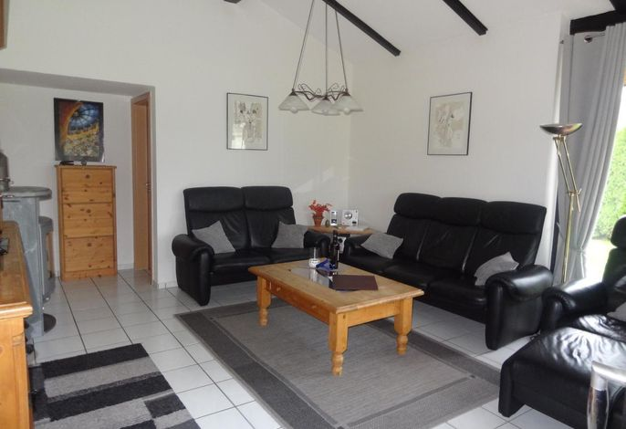 Wohnzimmer Ferienhaus J 4 mit Specksteinofen