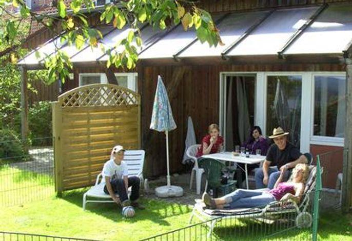 Ferienhaus mit Garten und Gartenumzäunung