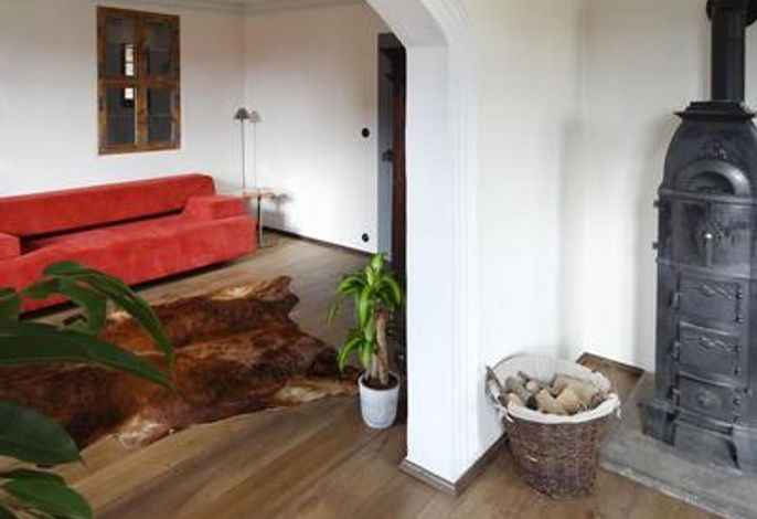 Wohnzimmer mit dem Schlafsofa von COR, Liegefläche 140 x 200 cm
