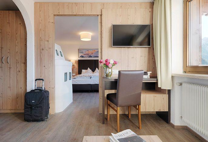 Suite mit Kachelofen und Infrarot-Kabine