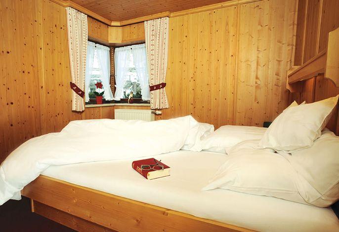 Schlafzimmer in der Wohnung Bergblick