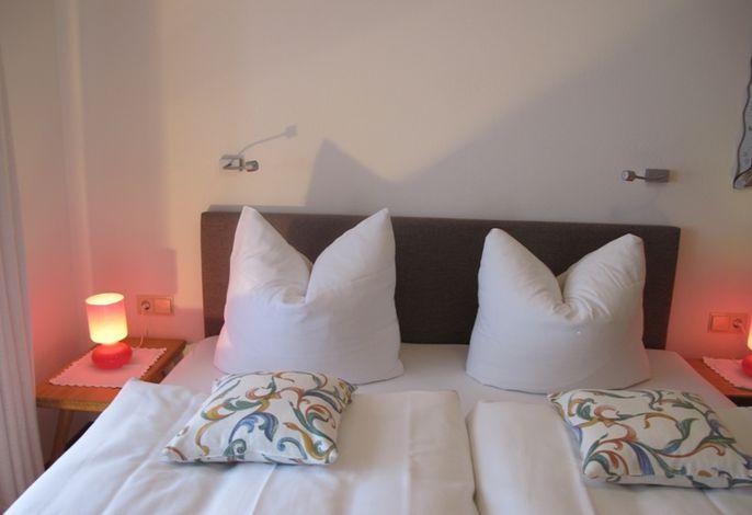 Schlafzimmerbeispiel im Ferienwohnhaus Bergstüberl