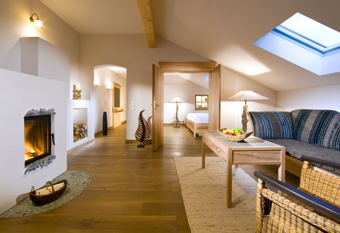 Wohn- und Schlafbereich Alpenmohn mit Kamin