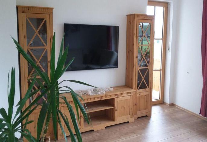 Wohnzimmer mit 55 TV und Soundbox