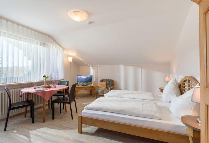 Wohn- und Schlafbereich in der Ferienwohnung Nr. E8