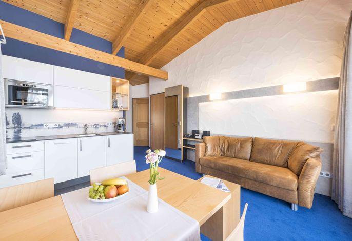 Ferienwohnung - Wohnzimmer mit Küchenzeile
