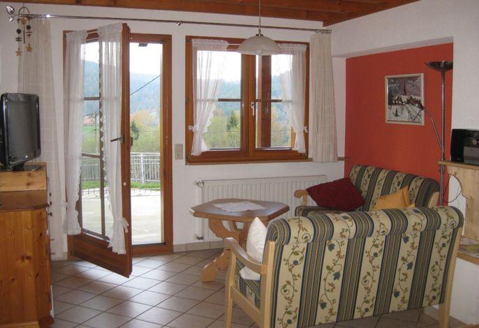 Sitzecke mit Ausgang zur Terrasse
