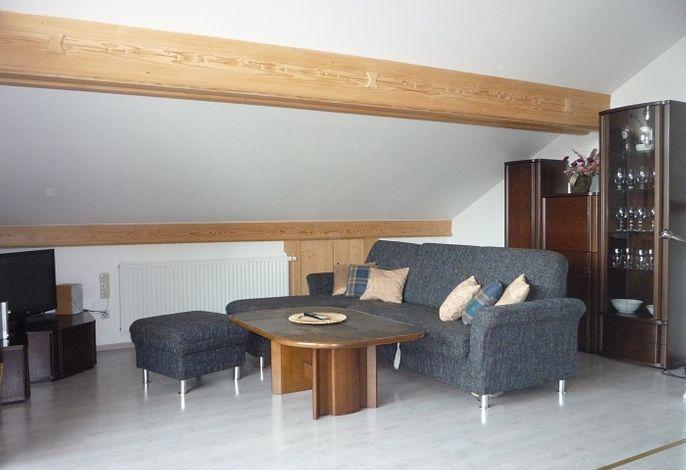 Wohnbereich mit ausziehbarem Sofa Dachgeschoss