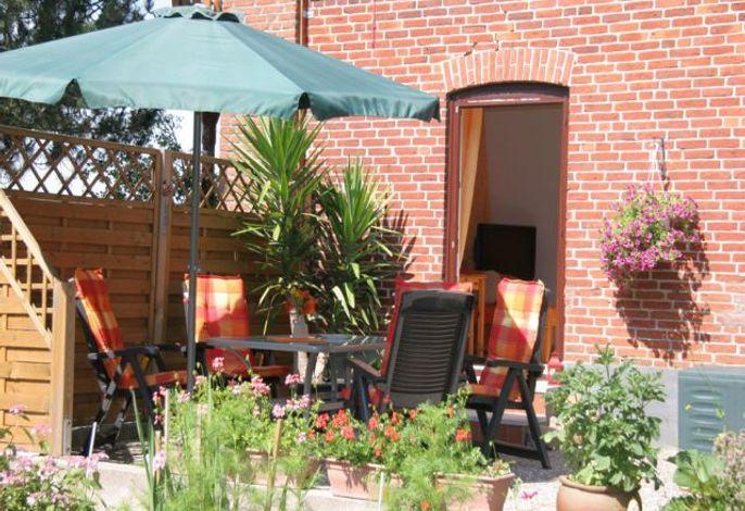 Terrasse mit Zugang ins Haus