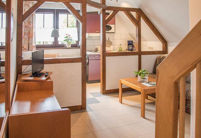 Fewo Seeblick im Landhotel: Wohnraum mit Küche