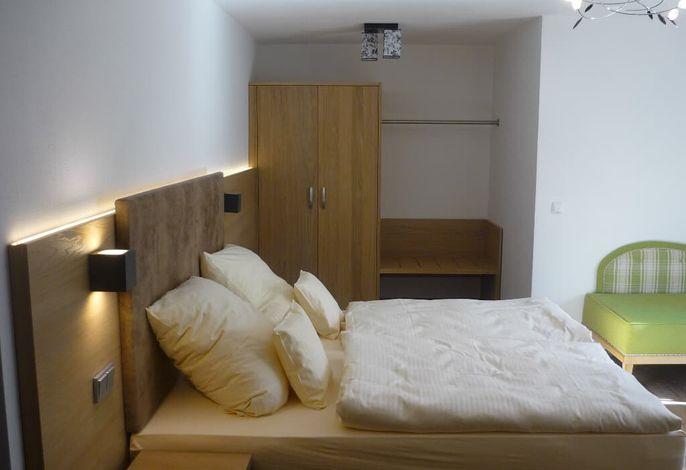 Woh-Schlafbereich mit Doppelbett