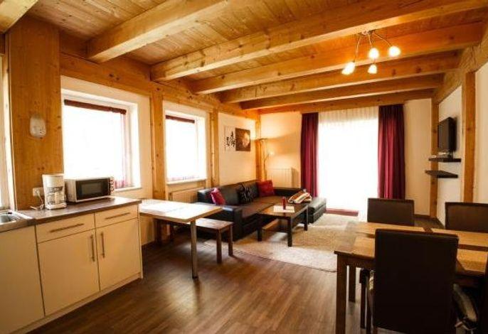 Wohnzimmer mit Küchenzeile in der Kategorie Economy