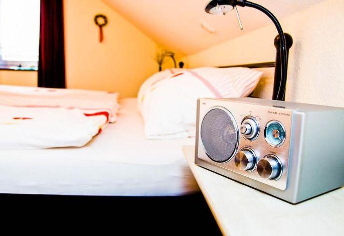 Schlafzimmer Ferienwohnung Zum Rosengarten
