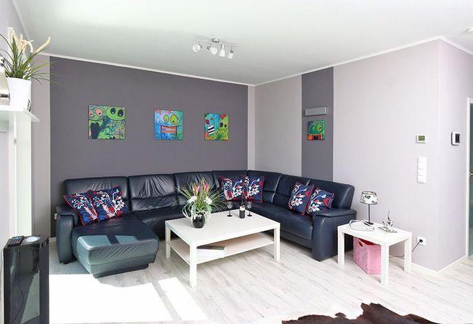 Bildschönes Wohnzimmer mit Sofaecke zum Ausspannen