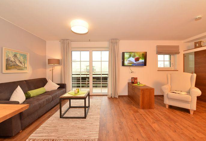 Wohnzimmer mit zusätzlichem Schrankbett