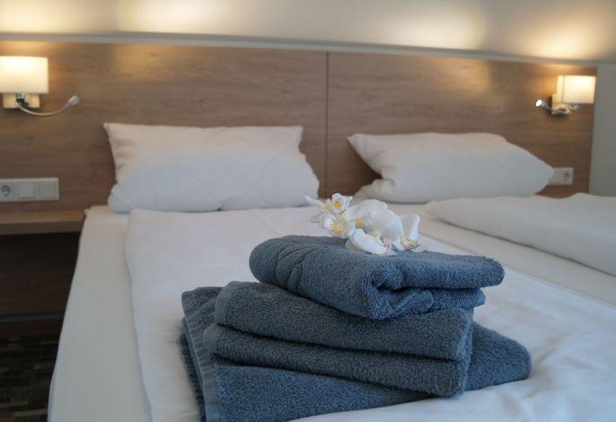 Doppelzimmer-Bett