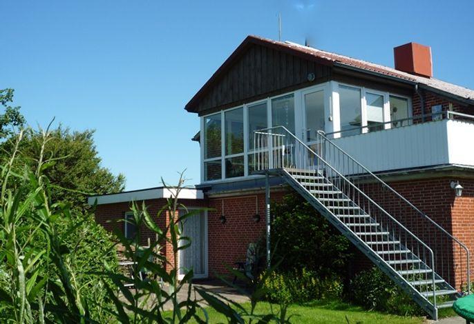 Wohnung 2 im 1. OG mit Wintergarten und Balkon