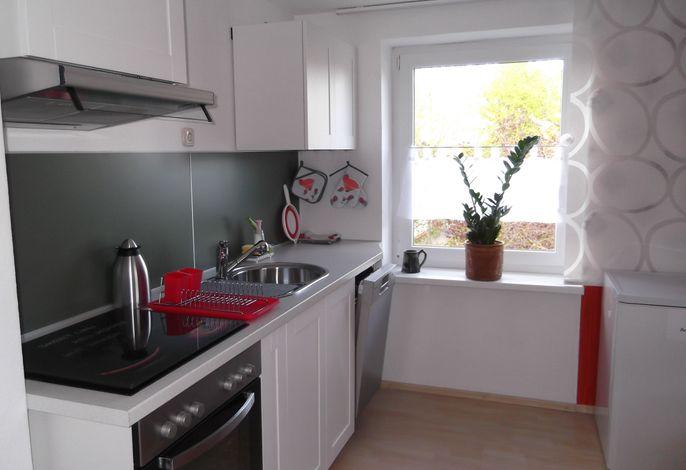 Voll ausgestattete Küche mit Sitzecke