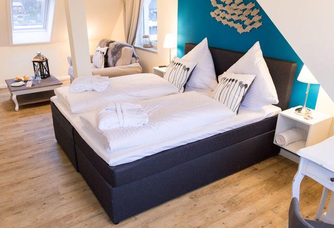 kombinierter Wohn- und Schlafbereich in der Junior Suite
