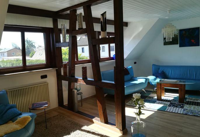 Wohnzimmer mit Fachwerk und Leder