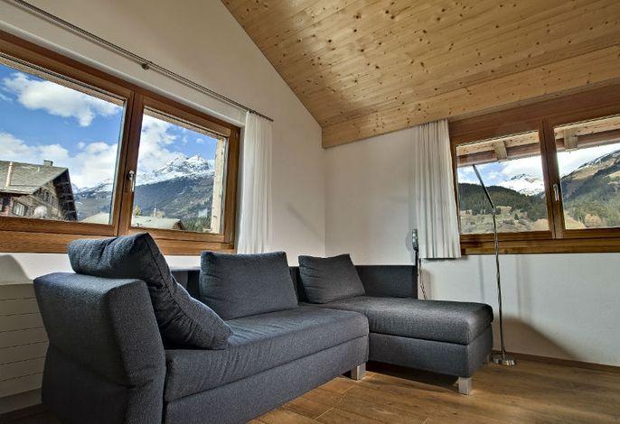 Familienhotel Alpina, Wohnraum Ferienwohnung