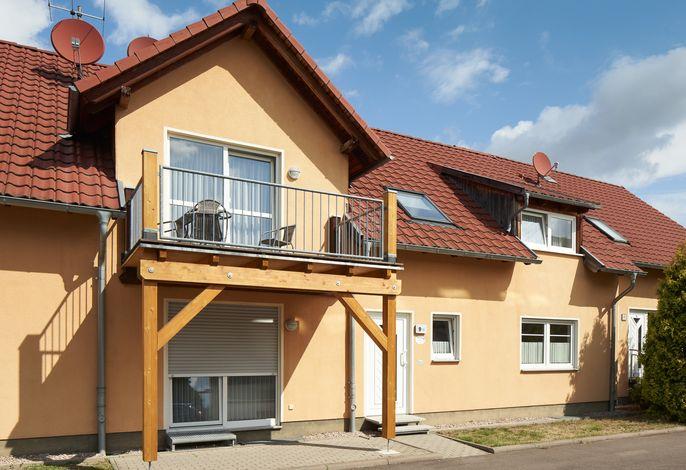 Ferienwohnung Am Waidweg - Außenansicht mit Blick auf die Balkone und Terassen 9B