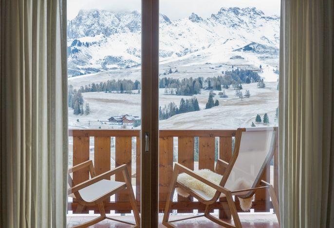 Erleben Sie ein atemberaubendes Postkarten-Panorama beim Einkehrschwung auf der Terrasse, beim Barfußlaufen im Almgras nach einem Saunagang oder einfach von Ihrem Balkon aus