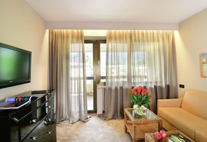 Hotel Pollinger **** – Eine Oase des Wohlbefindens im Herzen Merans und mitten im Grünen.