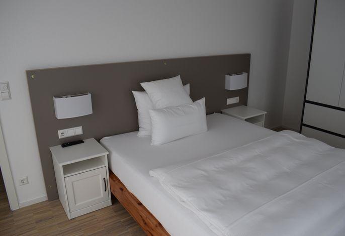 Warum-Ins-Hotel Boardinghouse