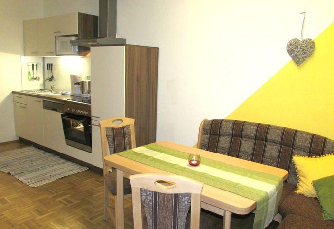 Wohnküche mit Sitzecke in der Ferienwohnung Morgensonne
