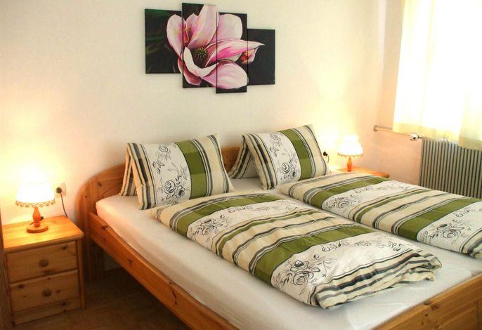 Schlafzimmer in der Ferienwohnung Koralpe