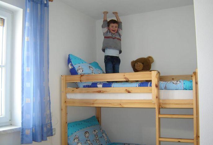 Schlafzimmer Ferienwohnung Dorfblick