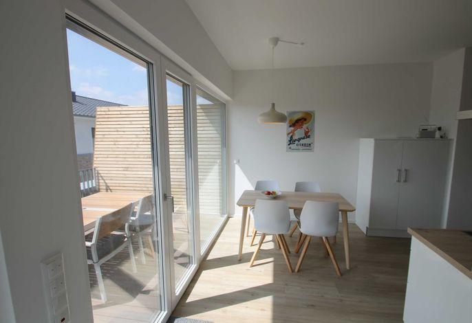 Essecke in den Wohnraum offen integriert