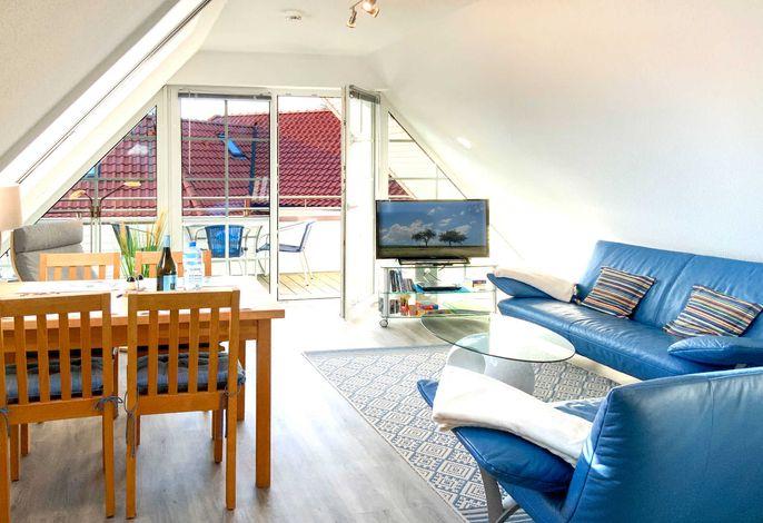 Wohn - u. Essbereich mit überdachter Terrasse