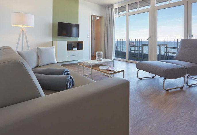 Wohnessbereich mit Couch und Fernseher