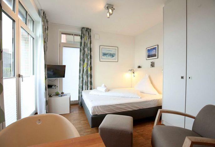 Wohn-/Essbereich mit Doppelbett