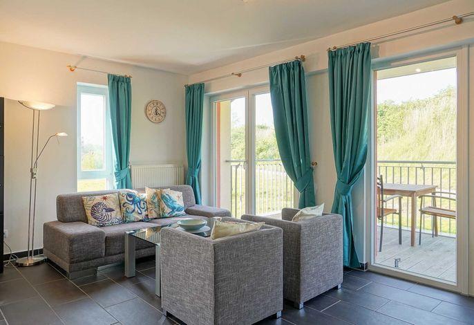 Wohn/Essbereich mit Zugang zum Balkon