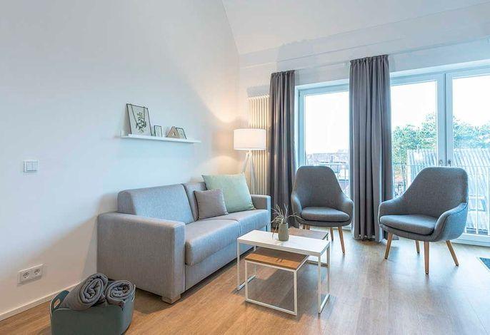 Wohnessbereich mit Couch und Sesseln