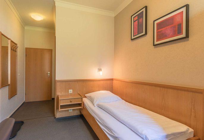 Einzelbett im Apartment Brasse