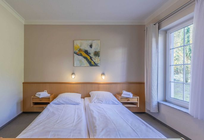 Doppelbett im Ferienapartment am Goldberger See