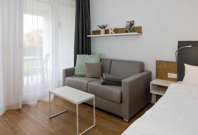 Wohn/Schlaf/Essbereich mit Couch