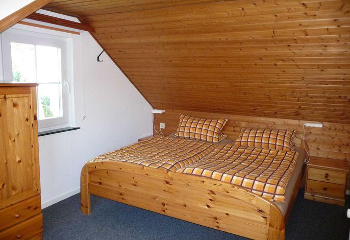 Schlafzimmer mit Verdunklungsrollos
