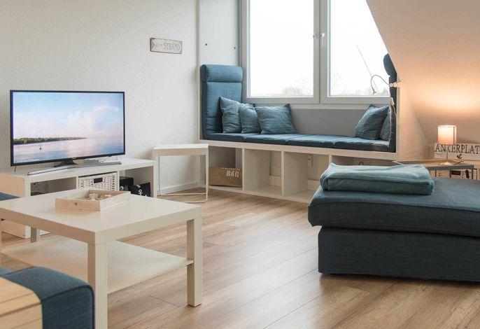 Ferienwohnung Heimathafen Wohnzimmer mit Fernseher