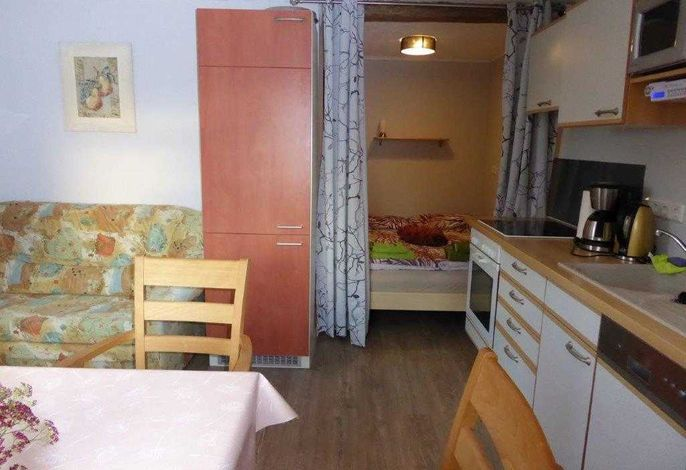 Wohnküche mit Schlafnische