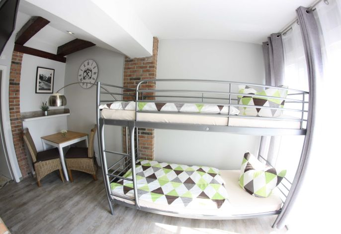 Wohn-/ Schlafbereich mit Etagenbett im Haus Ferienglück