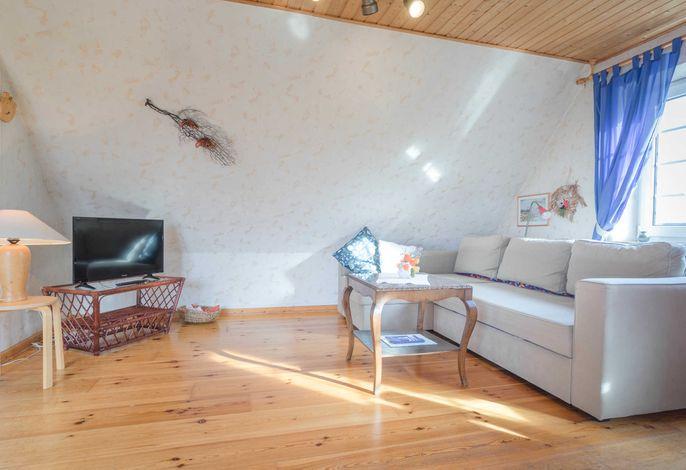 Das offene Wohnzimmer für gemütliche  Nachmittage und Abende auf dem Sofa.